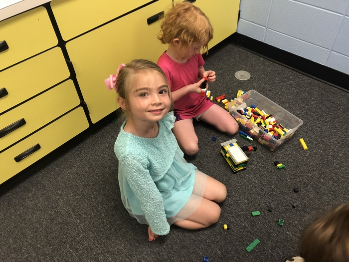 kindergarten students working on a team building Lego activity
