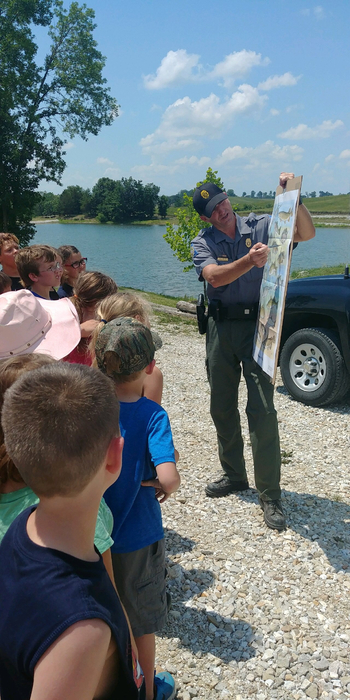 conservation agent Shannon Smith talking to the students about fish and fishing.